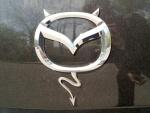 Улыбнула эмблема Mazda